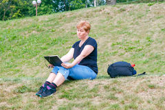 Woman draws in the park. Royalty Free Stock Image
