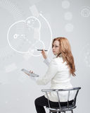 Woman draws water molecule Stock Image