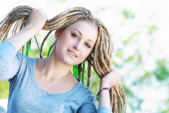 Woman with dreadlocks Stock Images
