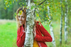 Woman with dreadlocks near birch Stock Photo