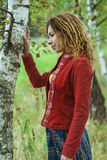 Woman with dreadlocks near birch Stock Image