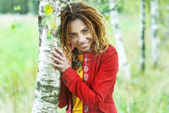 Woman with dreadlocks near birch Stock Photos