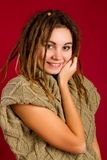 Woman with dreadlocks on a red background Royalty Free Stock Photo