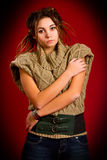 Woman with dreadlocks on a red background Stock Images
