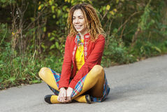 Woman with dreadlocks sitting in lotus position Stock Photography