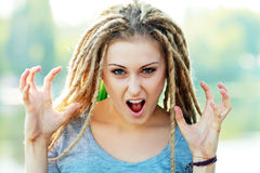 Woman with dreads making face Stock Images