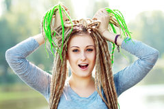Woman with dreads making face Royalty Free Stock Image