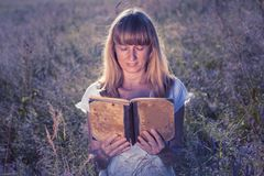 Woman dream with a book stock images