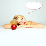 Woman dreaming. Woman looking at apple dreaming Royalty Free Stock Image