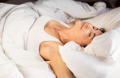 Woman dreaming in bed Royalty Free Stock Photo
