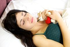 Woman dreaming of boyfriend in love holding plush Stock Images