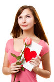 Woman dreaming with card and rose flower royalty free stock images