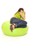Woman dreaming on chair. Woman dreaming on green comfortable chair Royalty Free Stock Image