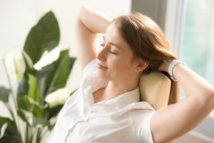 Woman dreaming with closed eyes in office chair. Beautiful woman dreaming with closed eyes in office chair. Businesswoman feels relaxed after busy working day Royalty Free Stock Photography