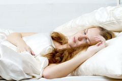 Woman dreaming in deb Royalty Free Stock Photos
