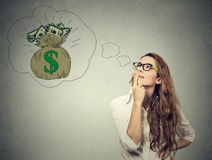 Woman dreaming of financial success Royalty Free Stock Images