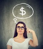 Woman dreaming of financial success. Thinking how to start a profitable business royalty free stock photo