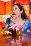 Woman dreaming on her taste of toast and jam, different flavors on the table.  Stock Photo