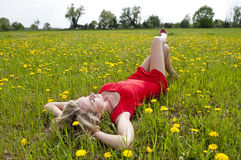 Woman dreaming in a meadow Stock Photography