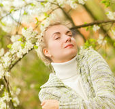 Woman dreaming outdoors Royalty Free Stock Photos