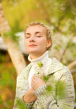 Woman dreaming outdoors Stock Image
