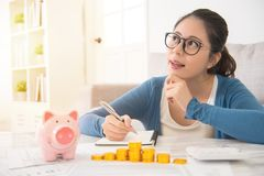 Woman dreaming and recording her savings Stock Photos