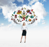 Woman is dreaming about sopping. Colourful shopping icons are flying in the air. Cloudy cloud on background. Stock Photography