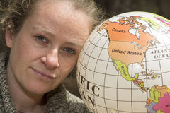 Woman dreaming travelling globe. Woman dreaming travelling holding world ball in hands Stock Photos
