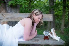 Woman dreaming on a wooden bench Royalty Free Stock Photography
