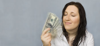 Woman dreams fanning with money Stock Photography