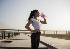 Woman dreanking water before the workout Royalty Free Stock Image