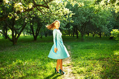 Woman in dress among apple blossoms Royalty Free Stock Photography