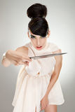 Woman in dress attacking with big kitchen knife Stock Photography