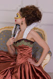 The woman in the dress of the Baroque style with a fan Royalty Free Stock Photography