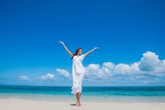 Woman in dress on beach Royalty Free Stock Photo