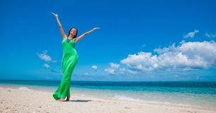 Woman in dress on beach stock photography
