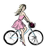 Woman in dress on bicycle Royalty Free Stock Photos