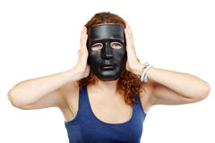 Woman in dress in black mask Royalty Free Stock Photography