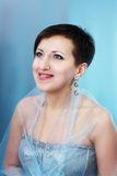Woman in dress on blue background Royalty Free Stock Image