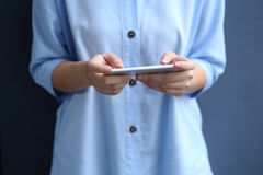 Woman dress blue shirt with using smartphone Stock Photos