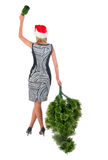Woman in  dress with a bottle of champagne and christmas tree Stock Photography