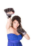 Woman in dress and boxing glove on white Stock Photos