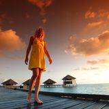 Woman in a dress on maldivian sunset Stock Images