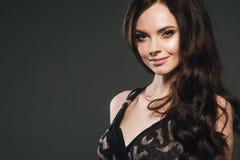 Woman in dress, brunette with long hair over dark background fem. Ale portrait. Studio shot stock images