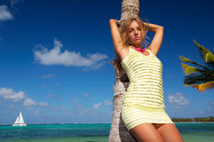 Woman in dress on caribbean beach Stock Images