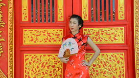 Woman in dress of Chinese traditional. Woman in red dress, Cheongsam dress of Chinese traditional