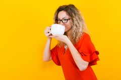 Woman in dress with cup Royalty Free Stock Photo