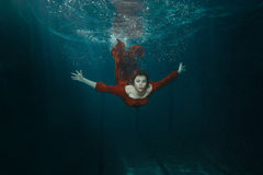 Woman in a dress dives. Royalty Free Stock Image
