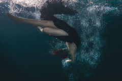 Free Woman Dress Dives Underwater. Royalty Free Stock Images - 74618849
