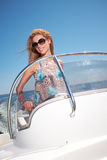 Woman  in Dress Driving A Speedboat Royalty Free Stock Photo